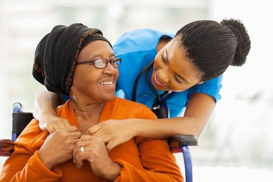 Home care agency caregiver assisting senior